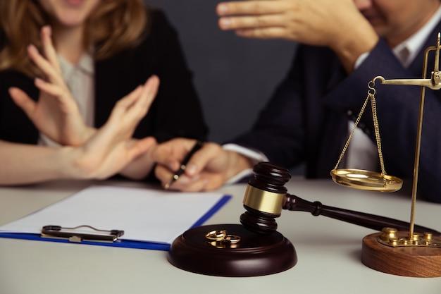 Judge gavel deciding on marriage divorce.