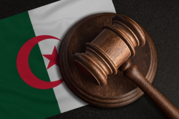 Judge gavel and flag of algeria. law and justice in algeria. violation of rights and freedoms.