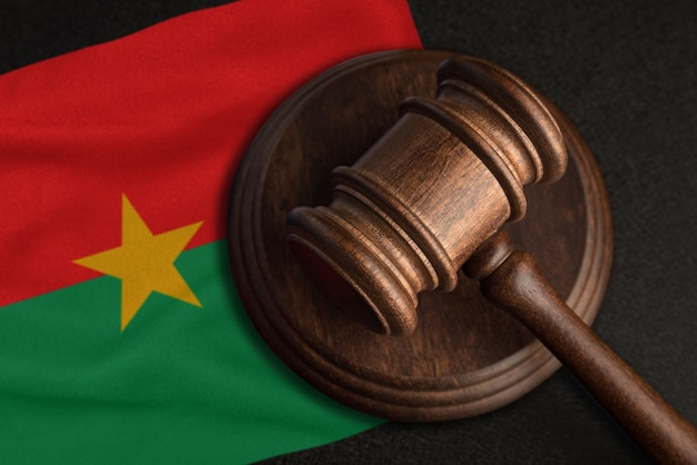 Judge gavel and flag of burkina faso. law and justice in burkina faso. violation of rights and freedoms.
