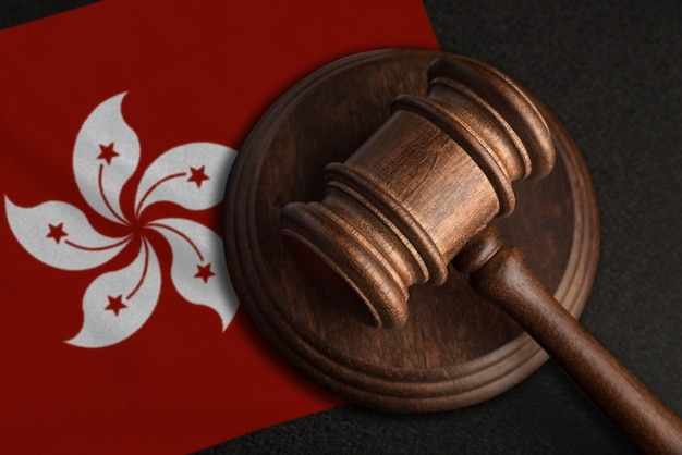 Judge gavel and flag of hong kong. law and justice in chile. violation of rights and freedoms.