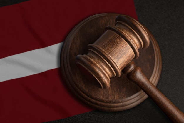 Judge gavel and flag of latvia