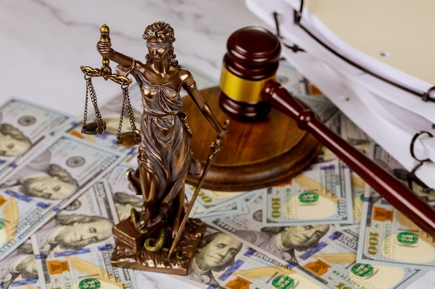 Judge gavel, lawyer office law and justice with a dollar sign corruption and venality concepts