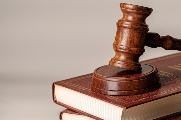 Judge gavel and legal book close up on table