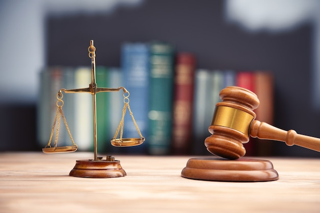 Judge gavel, scales of justice and law books.