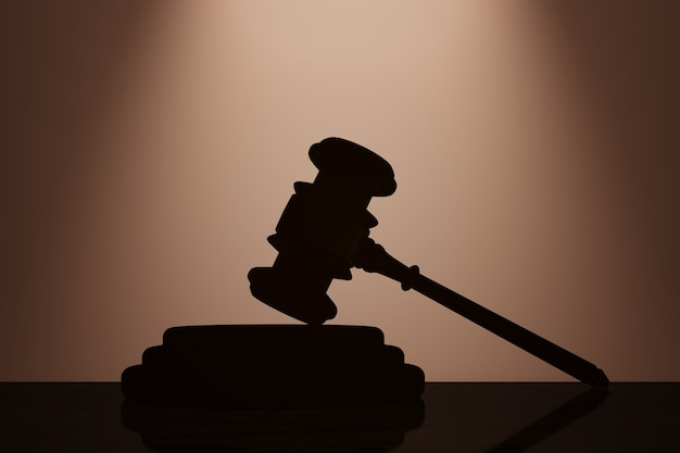 Judge gavel and sound block with backlight over wall in dark room. 3d rendering
