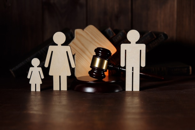 Judge gavel between split family figures