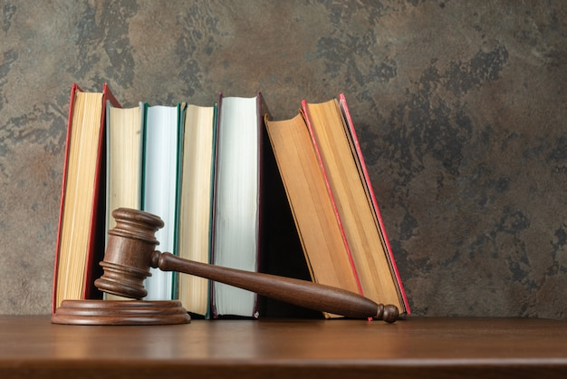 Judge gavel on the table with books