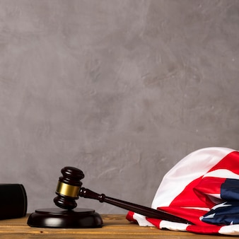 Judge gavel and united states flag with stucco background