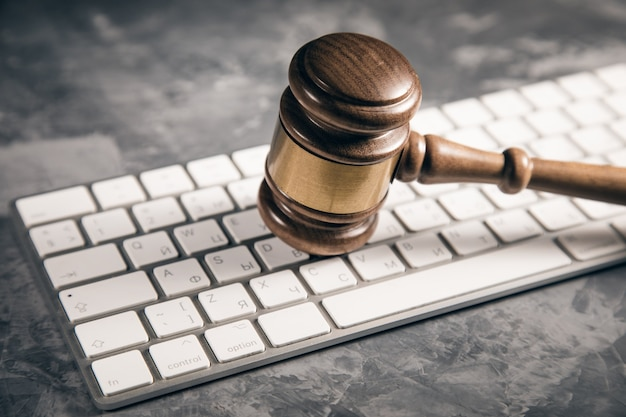 Judge gavel with computer keyboard. concept of internet crime