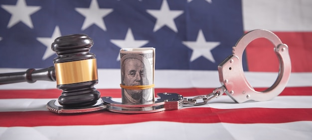Judge gavel with money and handcuffs.