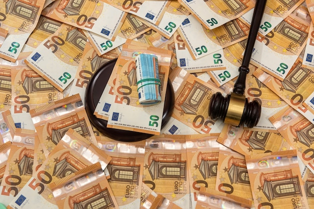 Judge hammer on 50 euro banknotes background