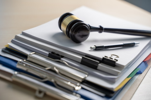 Judge hammer and business report papers, important documents