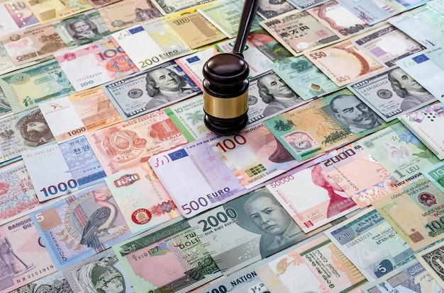 Judge hummer on various banknotes background close up