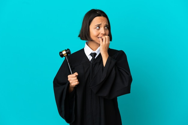 Judge over isolated blue background is a little bit nervous