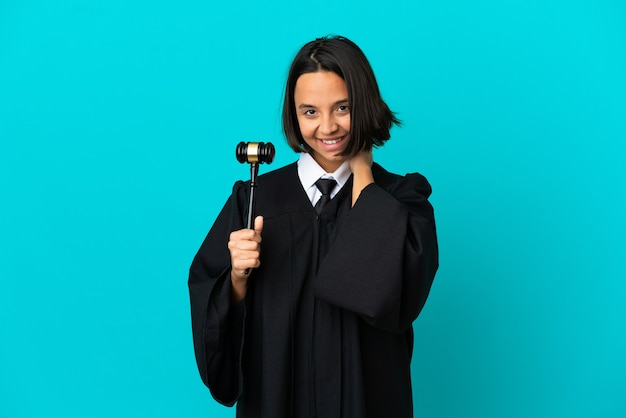 Judge over isolated blue background laughing
