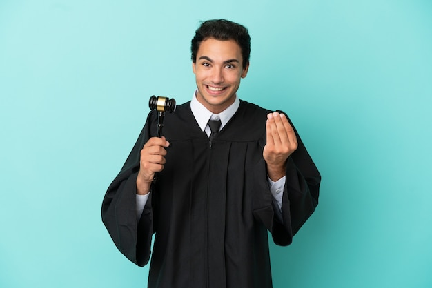 Judge over isolated blue background making money gesture