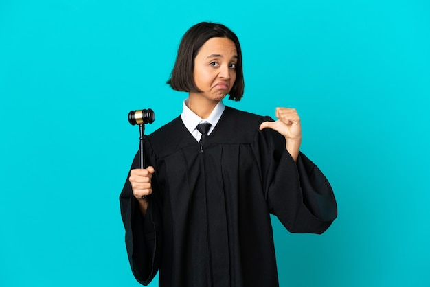 Judge over isolated blue background proud and self-satisfied