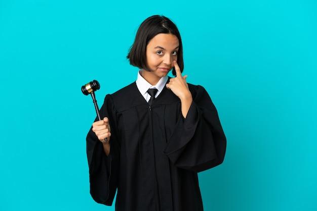 Judge over isolated blue background showing something