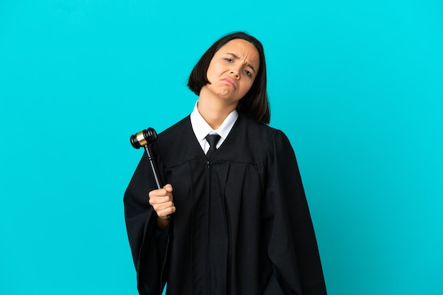 Judge over isolated blue background with an expression of frustration and not understanding