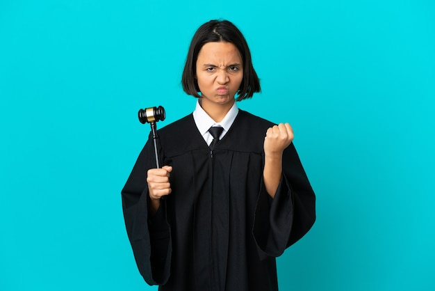 Judge over isolated blue background with unhappy expression
