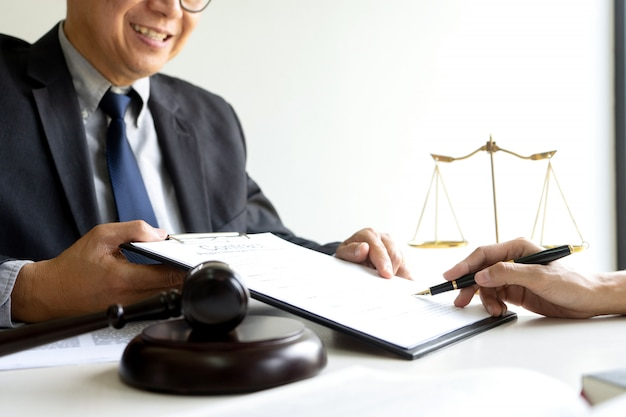 Judge or lawyer talking with a client