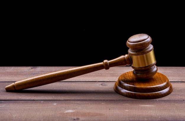 Judge's gavel over black background