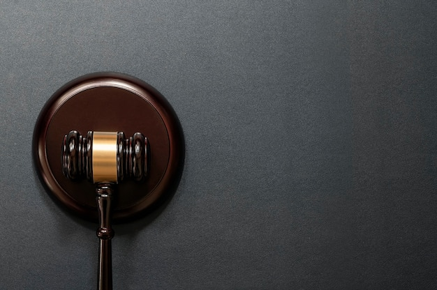 Judge's gavel on black leather background, top view. law concept.
