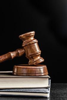 Judge's gavel over black