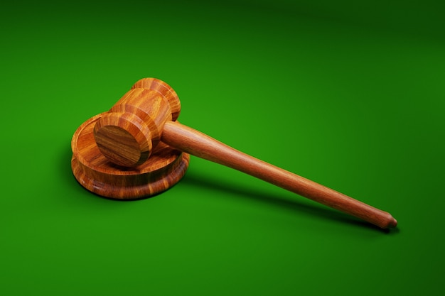 Judge's gavel on green background; law concept; 3d illustration