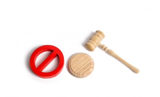 Judge's gavel and red symbol no