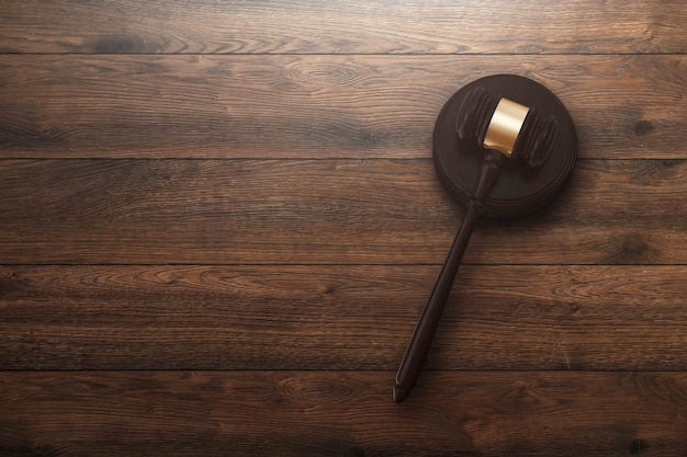 Judge's gavel on wooden background, top view