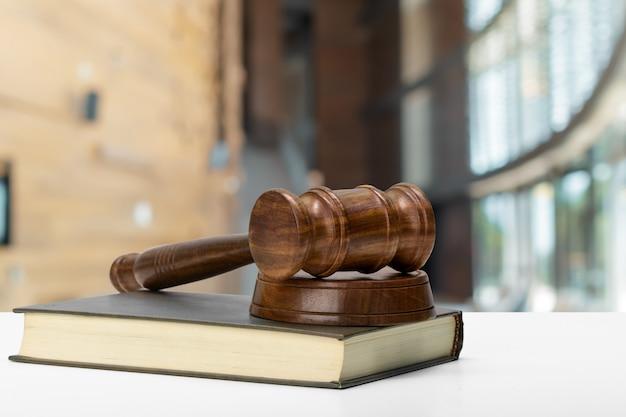 Judge's hammer on brown wood