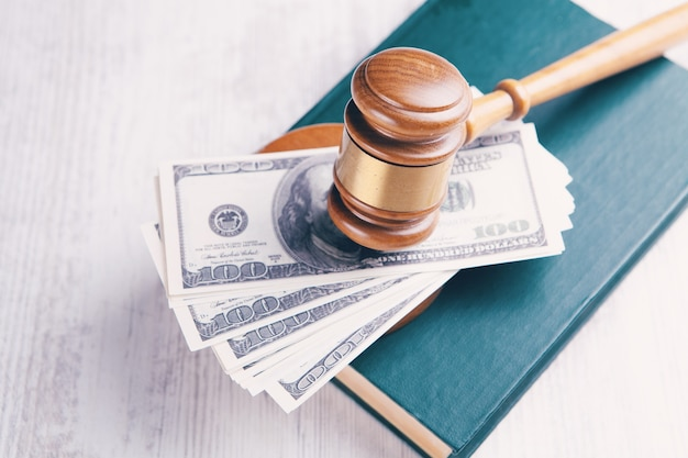 The judge's hammer on the money and on the book