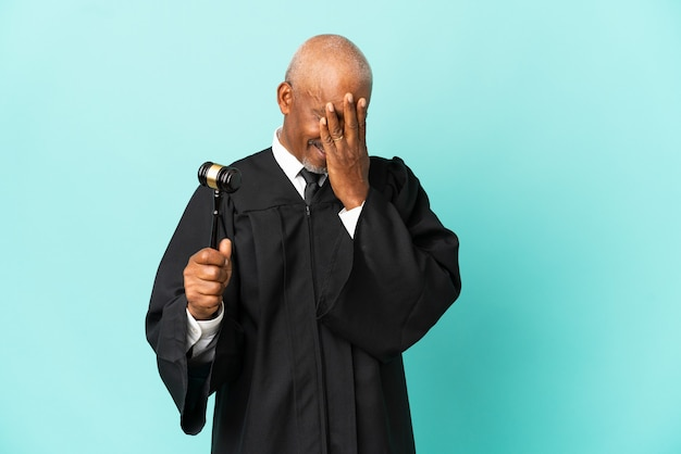 Judge senior man isolated on blue background with tired and sick expression