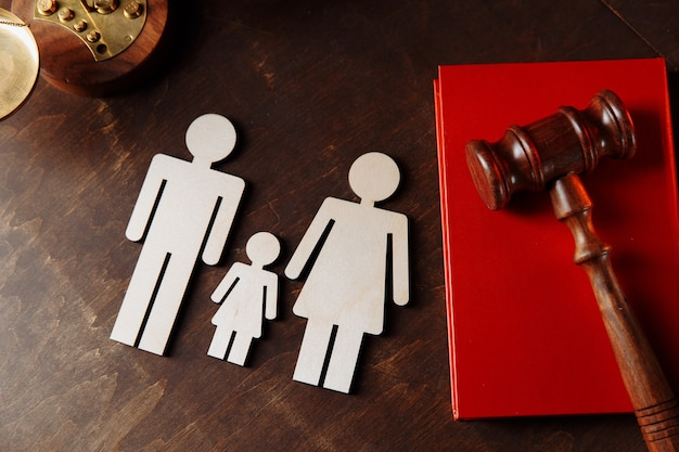 Judges gavel on book and family figures