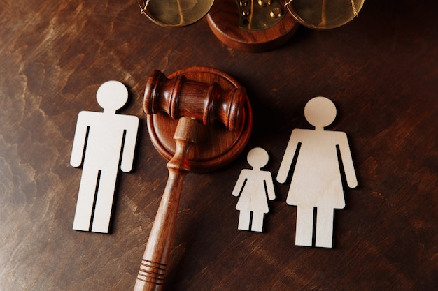 Judges gavel divide family figures