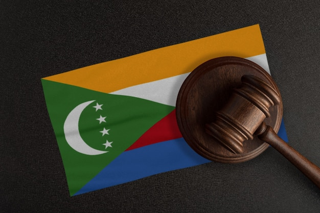 Judges gavel and the flag of comoros. law and justice. constitutional law.