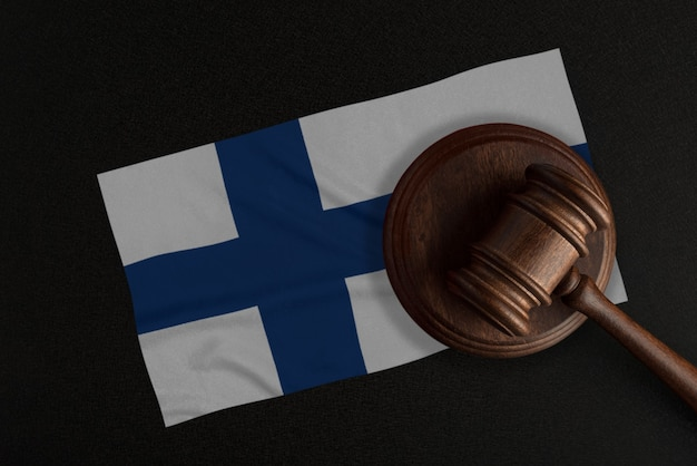 Judges gavel and the flag of finland. law and justice. constitutional law.