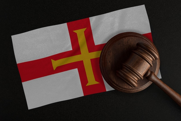 Judges gavel and the flag of guernsey
