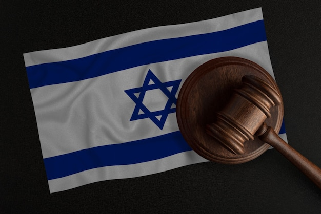 Judges gavel and the flag of israel