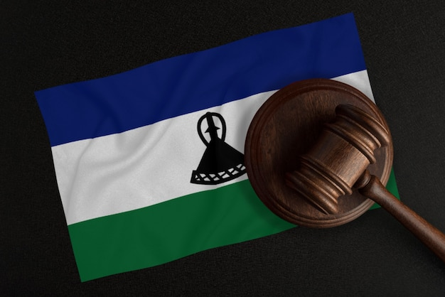 Judges gavel and the flag of lesotho. law and justice. constitutional law.