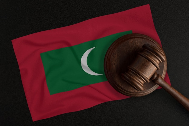Judges gavel and the flag of maldives. law and justice. constitutional law.