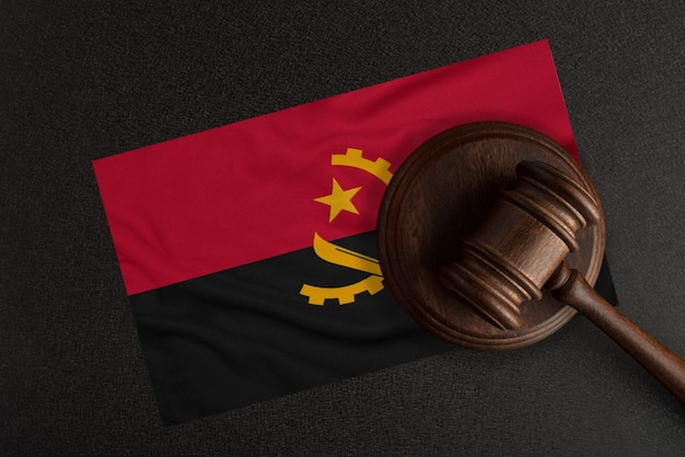 Judges hammer and the flag of angola. law and justice. constitutional law.