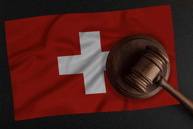 Judges hammer and the flag of switzerland. law and justice. constitutional law.