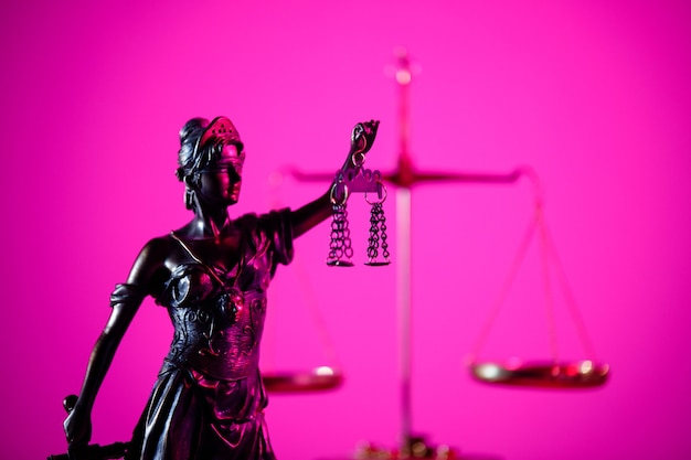 Judgment and law concept. figure of lady justice in notary office in purple neon.
