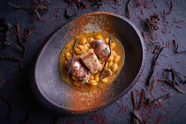 Judias pochas beans with calamari