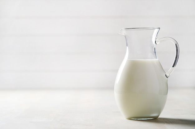 Jug of fresh milk with copyspace
