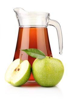Jug and glass of green apple juice with fruit isolated