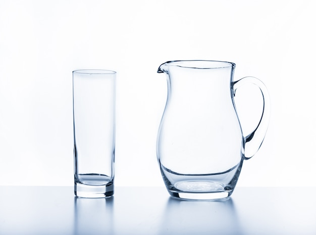 Jug and glass on a white background.