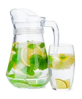 Jug of homemade lemonade isolated